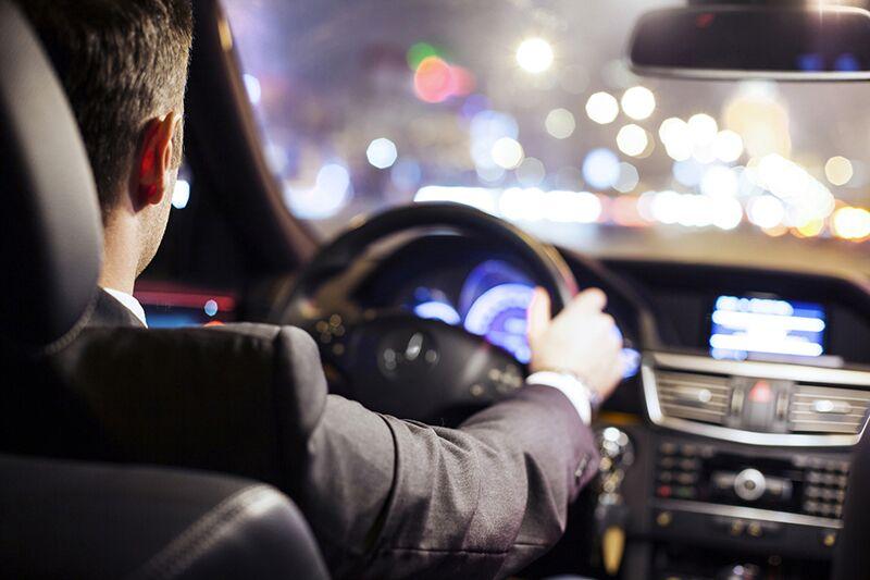 man driving through the city