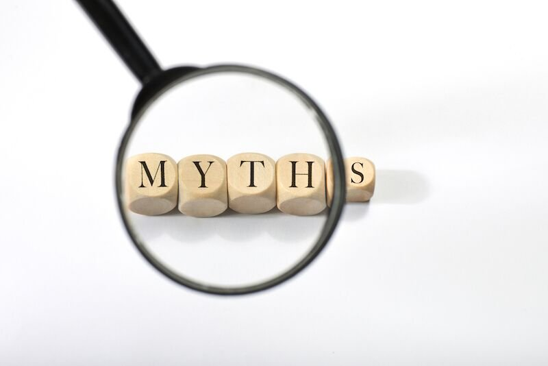 """the word """"myths"""" being examined with a magnifying glass"""